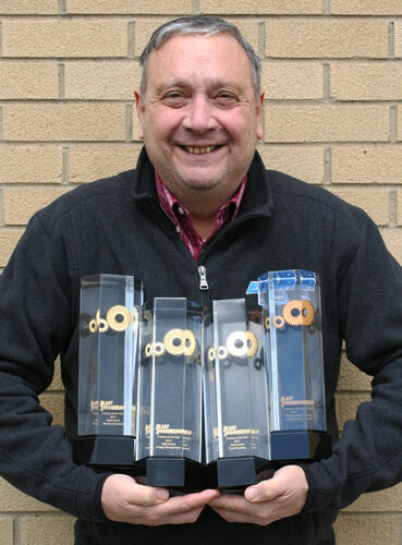 Joe Panfalone, Application Engineer extraordinaire, holding our bounty of product awards from 2013. He's retired since, but he's not...EVER...forgotten.