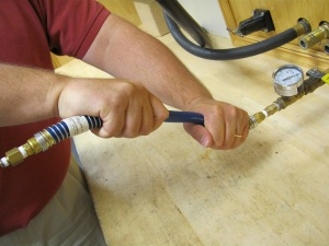 Hose is being held firmly at connection end, providing support for the element's connection inside the fitting.  DO THIS INSTEAD.