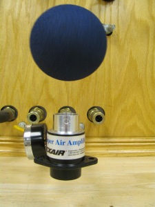 A Super Air Amplifier's air stream causes a foam ball to be suspended in mid air thanks to the Coandᾰ effect.