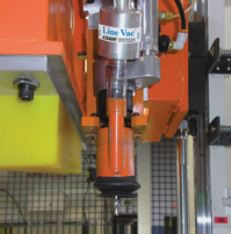 "Model 6080 3/4"" Line Vac is also used in point-of-machining applications, removing debris from the site altogether."